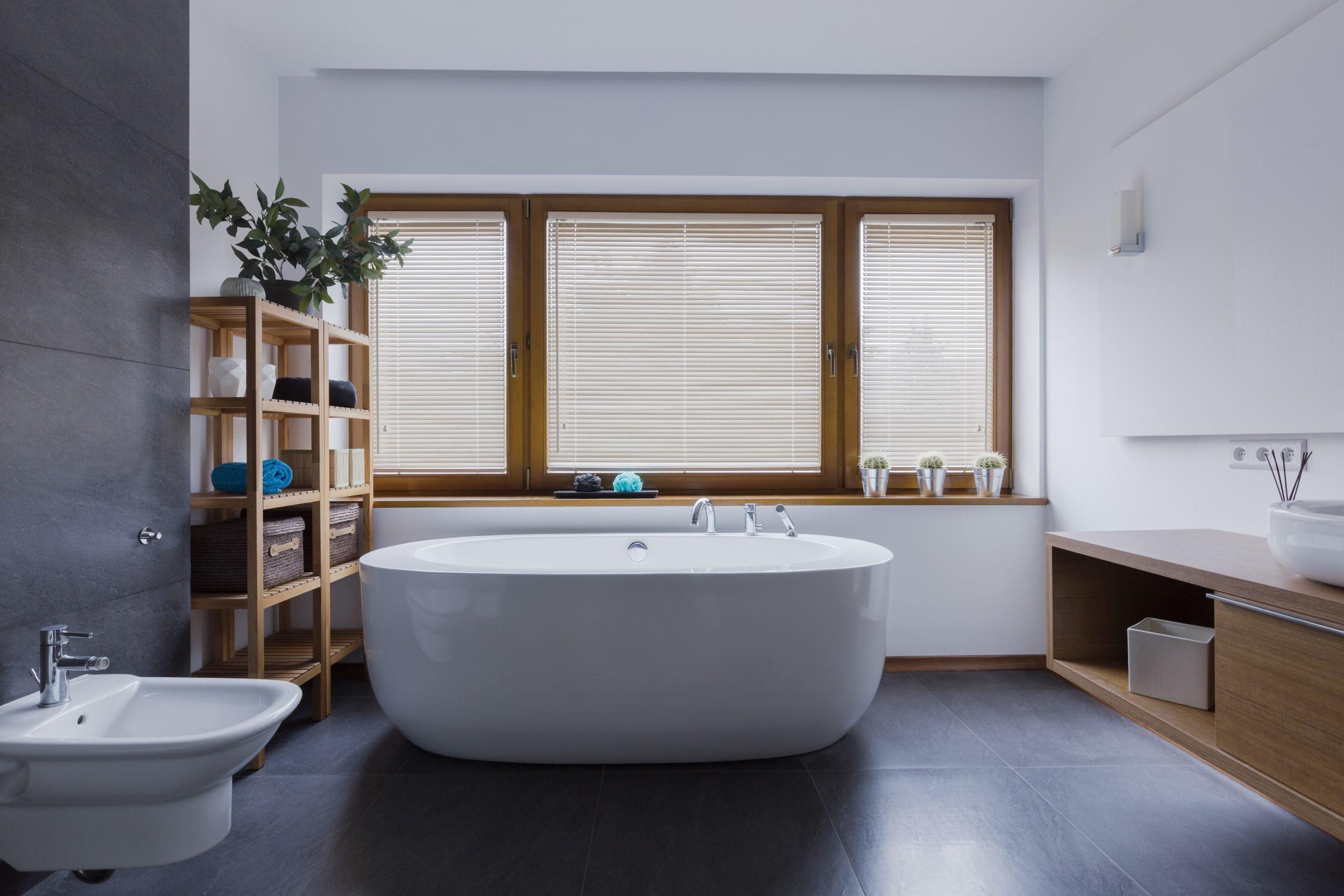 Spacious and comfortable bathroom with freestanding bathtub